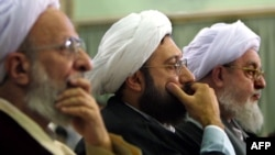 Ayatollah Mohammad Mohammadi Gilani (right) attends a meeting of the Assembly of Experts during the opening session of its annual assembly in Tehran in September 2002.
