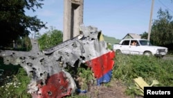 A piece of the wreckage is seen at a crash site of the Malaysia Airlines Flight 17 in the village of Petropavlivka in eastern Ukraine