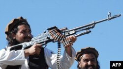 Taliban commander Hakimullah Mehsud (left) poses for media in the Mamouzai area of Pakistan in 2008
