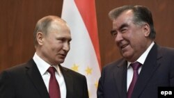Russian President Vladimir Putin and Tajik President Emomali Rahmon attend a signing ceremony following their talks in Dushanbe on February 27.