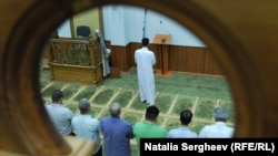 MOLDOVA, CHISINAU - Muslim men praying in a Moldovan mosque