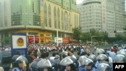 A U.S.-based Uyghur group issued this photo soon after the Xinxiang violence erupted, showing clashes in Urumqi.
