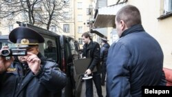 Police seize equipment from the Belsat TV station in Minsk on March 31.