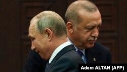 Recep Tayyip Erdogan (sağda) və Vladimir Putin ötən il Suriya danışqılarından sonra