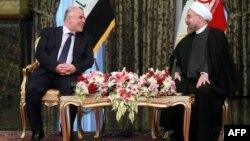 الرئيس الإيراني حسن روحاني يستقبل رئيس الوزراء العراقي حيدر العبادي في طهران 21/10/2014