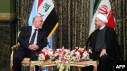 Hassan Rohani (djathtas) dhe Haidar al-Abadi gjatë takimit të tyre në Teheran