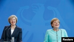 Theresa May i Angela Merkel, Berlin, 20. juli 2016.