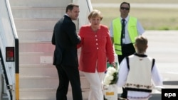 Moldovan Prime Minister Vlad Filat (left) welcomes German Chancellor Angela Merkel to Chisinau.