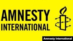 Amnesty International халықаралық ұйымының логотипі (Көрнекі сурет).