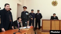 Armenia - Colonel Margar Ohanian (L), former chief of the national traffic police, speaks in a Yerevan court at the start of his his trial on corruption charges, 9Jan2012.