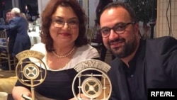 Radio Farda's Roya Karimi Majd and Kambiz Hosseini win trophies at the 2015 New York Festivals, June 22, 2015.