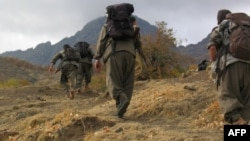 Kurdistan Workers Party (PKK) fighters walk in mountains from Turkey through the border with Iraq in early May.