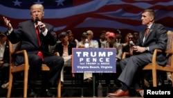 Republican presidential nominee Donald Trump (left) speaks alongside retired U.S. Army Lieutenant General Michael Flynn during a campaign town hall meeting in Virginia Beach, Virginia, in September 2016.
