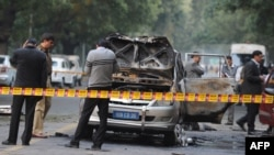 Investigators work at the site where a vehicle exploded near the Israeli Embassy in New Delhi on February 13.
