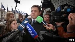 Министр энергетики России Александр Новак перед переговорами в Брюсселе, посвященными сделке по газу между Украиной и Россией, 29 октября 2014 года.