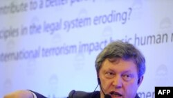Grigory Yavlinsky gestures as he delivers a speech during the 15th Forum 2000 Conference in Prague on October 10.