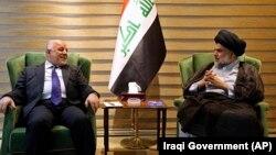 در این تصویر از ماه گذشته صدر و عبادی در دیداری که در بغداد انجام دادند