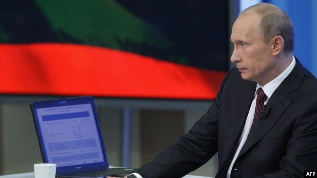 Vladimir Putin listens to a question during an annual televised phone-in show in Moscow in 2009.