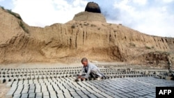 A 10-year-old boy works at a brick factory on the outskirts of Kabul. (file photo)