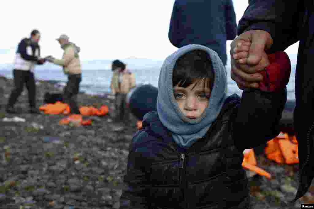 A Syrian refugee child looks on, moments after arriving on a raft with other Syrian refugees on a beach on the Greek island of Lesbos. (Reuters/Giorgos Moutafis)