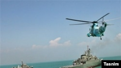 Iran begins navy drill off Strait of Hormuz as US newly wary