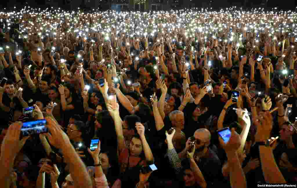 People light up their mobile phones as they attend a protest rally in front of the old parliament building in Tbilisi, Georgia, on May 31. Thousands gathered to protest what they said was political influence in the trial of teens allegedly involved in the stabbing death of two teenage boys in a brawl in December. (Reuters/David Mdzinarishvili)