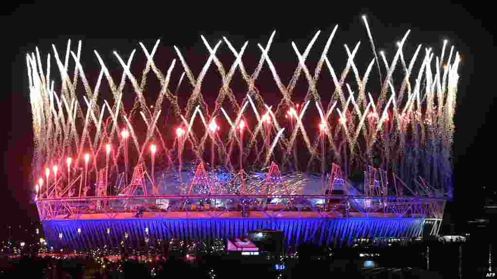 Fireworks light up the Olympic Stadium during the opening ceremonies of the London 2012 Games in the early mornings hours of July 28. (AFP/Indranil Mukherjee)