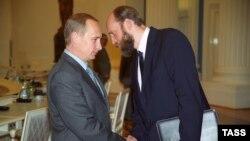 Президент Росії Володимир Путін і банкір Сергій Пугачов (праворуч), архівне фото, 2000 рік