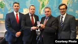 U.S. Representative Chris Smith (2nd right) receives an award from Belarusian opposition activists in May 2019.