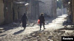 Civili i oštećene zgrade u Homsu, 2. lipanj 2012.