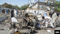 Pakistani security officials inspect the scene of a suicide bomb attack in Quetta on June 23.