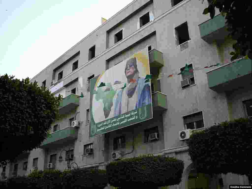 Qaddafi spent the 1990s and 2000s as a proponent of pan-Africanism. Apartment blocks, like these in Tripoli, are often adorned with homages to the leader. (Photo by Quigibo)