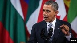 """Обама Брюсселдеги билдирүүсүндө Орусия """"орой күч колдонуу"""" аркылуу максатына жете албай турганын айтты. 26-март, 2014"""