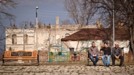 Azerbaijan - men sit in a square in the town of Shusha, Nagorno-Karabakh, 25 March 2014.