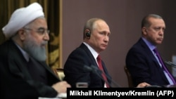 Iranian President Hassan Rohani (left) Russian President Vladimir Putin (center), and Turkish President Recep Tayyip Erdogan address the media after a trilateral meeting on Syria in Sochi, November 22, 2017