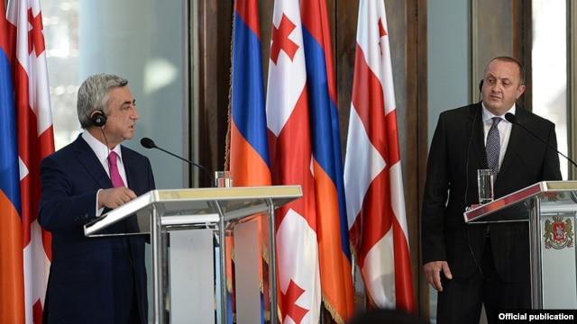Georgia - President Giorgi Margvelashvili (R) and his Armenian counterpart Serzh Sarkisian at a joint news conference in Tbilisi, 18Jun2014.