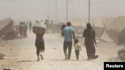 Syrian refugees arrive at the Al Zaatri refugee camp in the Jordanian city of Mafraq late last month.