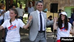 Armenia - Prime Minister Tigran Sarkisian dances with Syrian Armenian children at a summer camp in Hankavan, 13Aug2012.