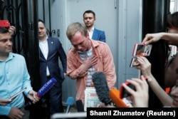 Russian journalist Ivan Golunov gestures to reporters after being released from police custody in June 2019.
