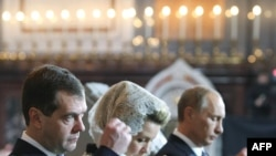 President Dmitry Medvedev (left) and Prime Minister Putin at the enthronememnt of the new Russian Orthodox patriarch on February 1