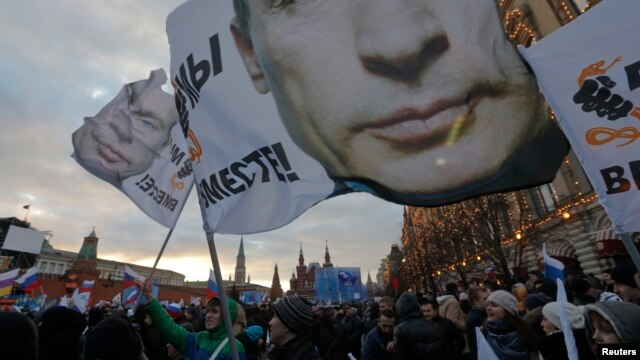 "People attend a rally called ""We are together"" to support the annexation of Ukraine's Crimea to Russia in Red Square in central Moscow on March 18."