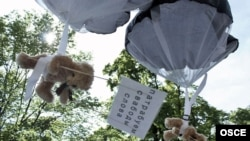 Teddy bears with pro-democracy messages were parachuted into the outskirts of Minsk from a light aircraft chartered by a Swedish public relations firm in early July.