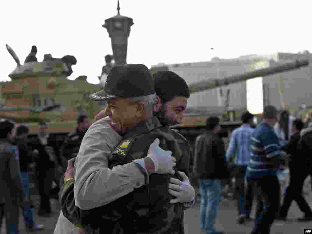 A man hugs an army commander in Cairo's Tahrir Square on February 12, the morning after Mubarak's resignation.