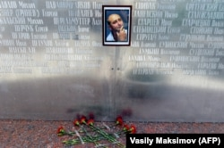 Flowers lay under a picture of Babchenko on the memorial wall of Russia's Union of Journalists in Moscow on May 30.