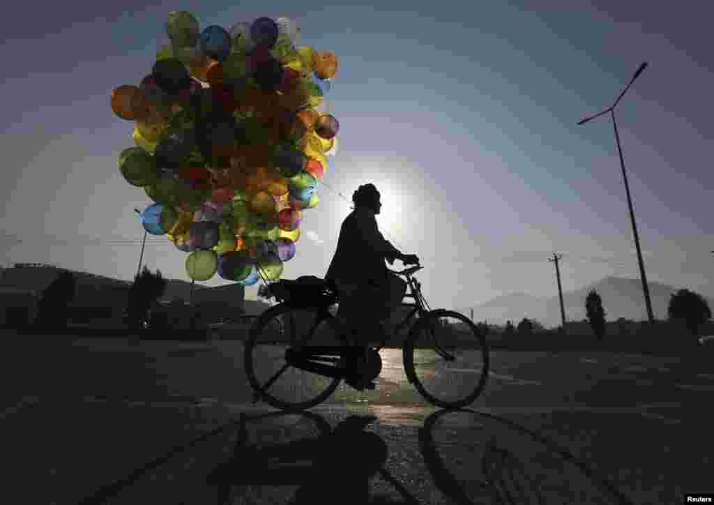 A balloon vendor rides his bicycle in Kabul. (Reuters/Omar Sobhani)