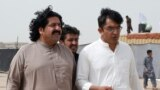 Ali Wazir (L) and Mohsin Dawar, leaders of the Pashtun Tahaffuz Movement (PTM) walk at the venue of a rally against, what they say, are human rights violations by security forces, in Karachi, May 13, 2018