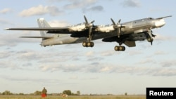 A Russian TU-95 Bear bomber making a landing (file photo)