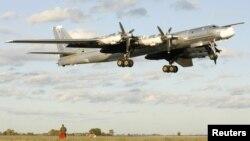 A Russian TU-95 Bear bomber making a landing (file photo)