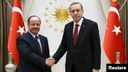Turkish President Recep Tayyip Erdogan (right) meets with Iraqi Kurdish regional President Masud Barzani at the Presidential Palace in Ankara on December 9.