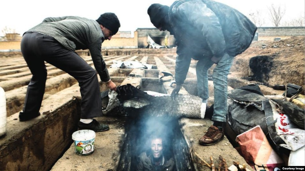 Images like this of homeless people living in graves has sparked outrage in Iran.
